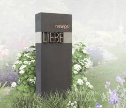 Modern grafmonument met brons